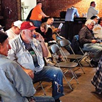 Bidders at an equipment auction on Oct. 23.