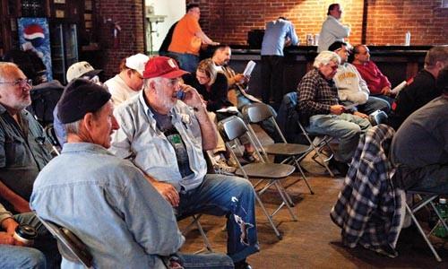 Bidders at an equipment auction on Oct. 23. - BRIAK KALDORF