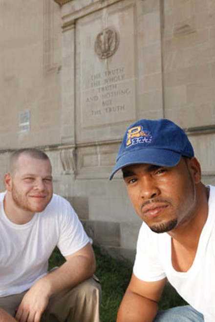 Boaz and DJ Shef in front of Boaz's alma mater, Westinghouse High School - PHOTO BY HEATHER MULL