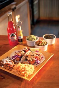 Breaded cod fish tacos, topped with red cabbage, mango salsa and chipotle-Dijon sauce - CAROLINE MOORE
