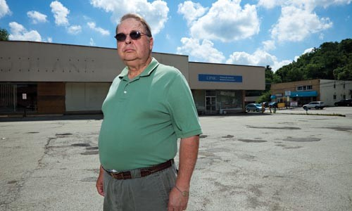 """Brookline resident Bob Beiler says UPMC is holding the community """"hostage,"""" stalling plans for a new grocery store by not moving a medical practice. - BRIAN KALDORF"""