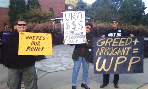"Carl Suter (right, with ""greed"" sign) has been battling the West Pittsburgh Partnership for years, including this protest held outside its office this past September."