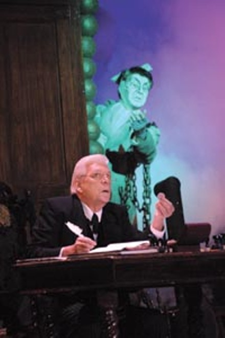 Chains we can believe in: Tom Atkins, as Scrooge, and Dereck Walton, as Marley's ghost, in the CLO's A Musical Christmas Carol. - PHOTO COURTESY OF MATT POLK.