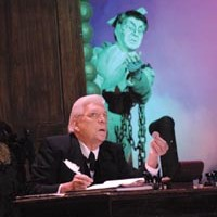 Chains we can believe in: Tom Atkins, as Scrooge, and Dereck Walton, as Marley's ghost, in the CLO's <i>A Musical Christmas Carol</i>.
