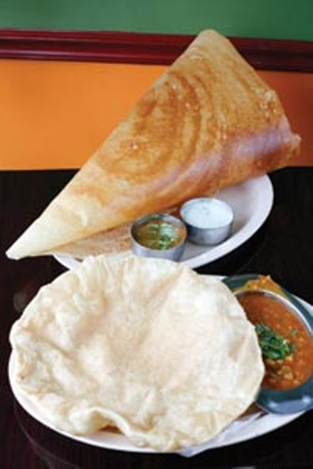 """Channa batura, fried """"puffy bread"""" served with chickpeas in a spiced tomato sauce, and a dosai with samber and chutney - HEATHER MULL"""
