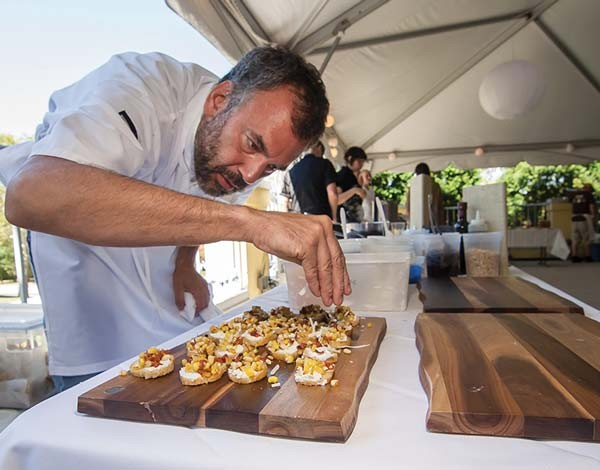 Chef Bill Fuller prepping food at last year's A Taste of Grow Pittsburgh.
