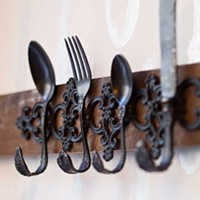 Butcher and the Rye Coat hook in the street level dining nook fashioned from reclaimed silverware. Photo by Heather Mull