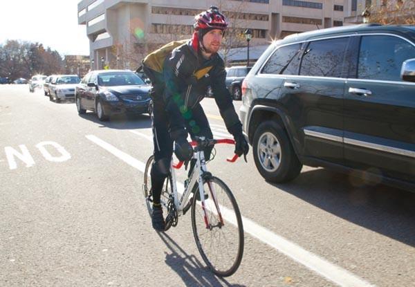 Colin Albright bikes in Oakland.