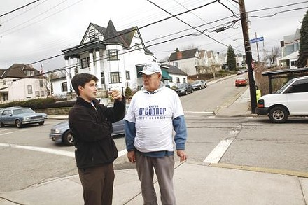Corey O'Connor chats with supporter William Carey on a recent afternoon in Greenfield. - HEATHER MULL