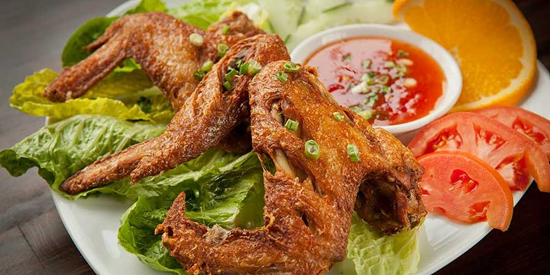 Thai Cottage Cottage wings with sweet chili sauce Photo by Heather Mull