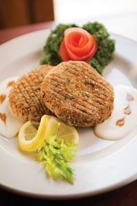 Crab cakes in garlic-butter sauce - BRIAN KALDORF