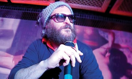 Cracked actor: Joaquin Phoenix rocks the mic.