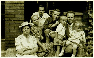 Andy Warhol and his family outside the family home on Dawson Street, in Oakland, circa 1945 - PHOTO COURTESY OF ANNE WARHOLA