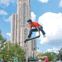 Daniel Mahoney, 16, of Truro, Nova Scotia, performs in front of the Cathedral of Learning as part of Pogopalooza 6.