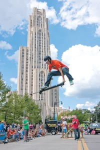 Daniel Mahoney, 16, of Truro, Nova Scotia, performs in front of the Cathedral of Learning as part of Pogopalooza 6. - JOHN ALTDORFER