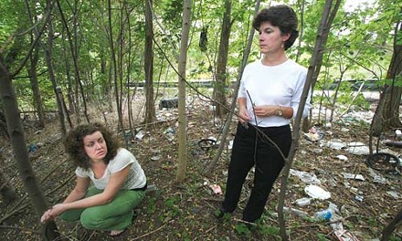 Danielle Crumrine (left) and Mary Wilson, executive director of PA CleanWays of Allegheny County, examine a site near Garfield Heights.