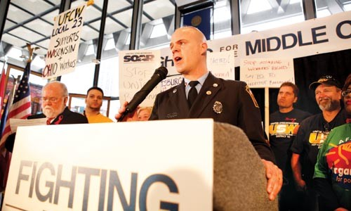 Darrin Kelly, a trustee for the Pittsburgh firefighters' union, speaks to the crowd at a Feb. 24 labor rally. - HEATHER MULL