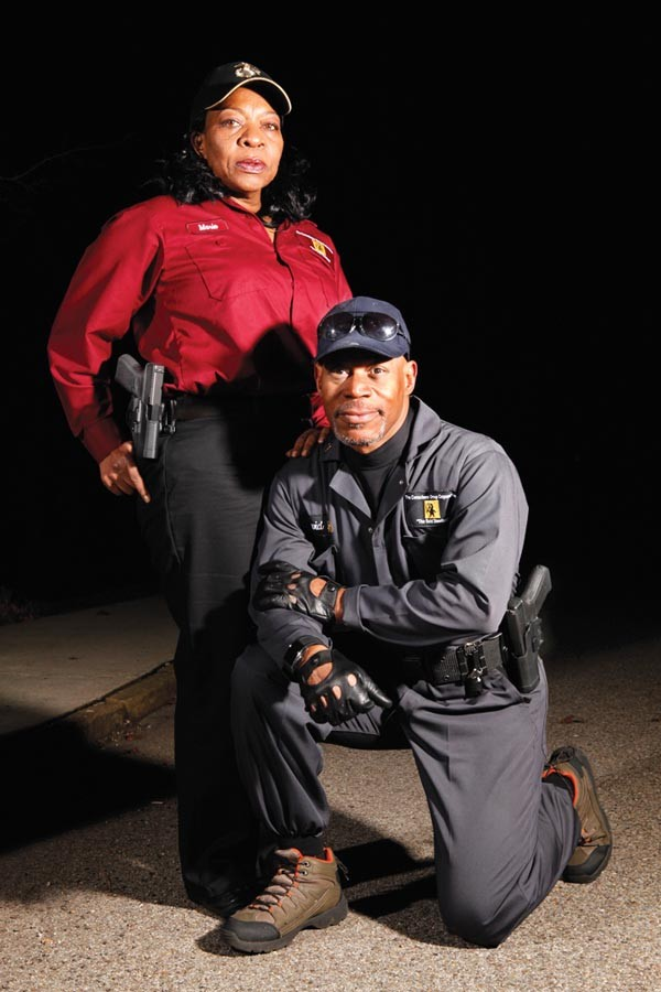 Dave Adams, in the Conscience Group's tactical suit, and Marie Blair in the group's standard uniform - PHOTO BY HEATHER MULL