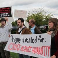 Demonstrators opposing Paul Kagame's partnership with CMU