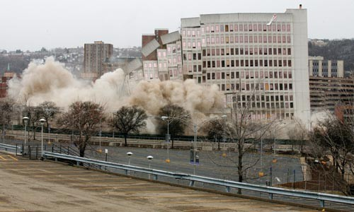 Despite the lack of a CBA with Hill District groups, preparation for a new hockey arena -- such as the implosion of the old St. Francis Hospital -- continues. - HEATHER MULL