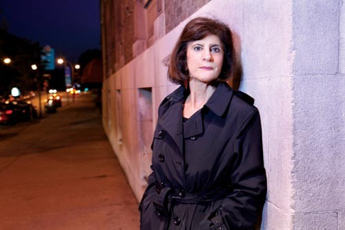 Detective author Kathleen George, trench-coated, has just published her fifth thriller, Hideout. - PHOTO BY HEATHER MULL
