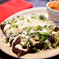 Reyna's Enchiladas in mole sauce Photo by Heather Mull