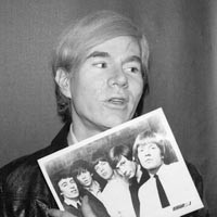 England's newest hitmakers: Andy Warhol with a 1964 Rolling Stones publicity photo.
