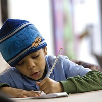 Faith and Tyrek's sibling A.J. does his math homework