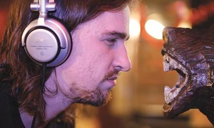 Far-out: DJ Cutups stares down the Bloomfield Bridge Tavern's signature bear. - HEATHER MULL