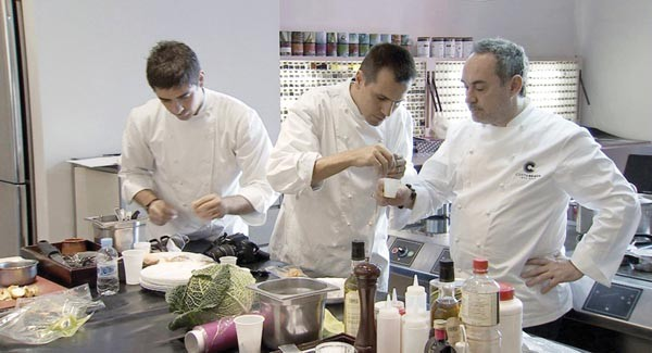 Ferran Adrià (right) and his chefs at work in the test kitchen.