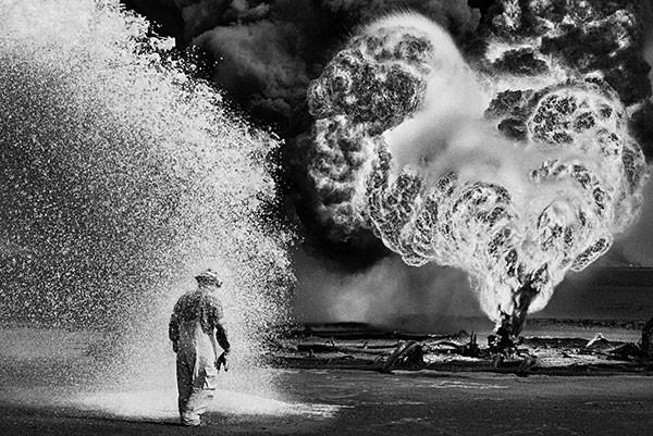 Fireman working in Kuwaiti oil fields after the 1991 Gulf War - PHOTO BY SEBASTIÃO SALGADO, COURTESY OF © SEBASTIÃO SALGADO/AMAZONAS IMAGES/SONY PICTURES CLASSICS