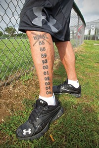Former Coach Bill Palermo had the years of the team's 10 WPIAL championship titles tattooed on his leg.