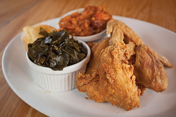 Fried chicken wings with greens, sweet potato and cornbread