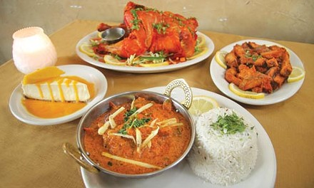 (from left, clockwise) mango cheesecake, tandoori chicken, desi aloo and chicken tikka masala - HEATHER MULL