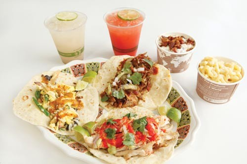 From left, egg, barbecued rib and chicken tacos, with drinks (horchata and watermelon agua fresco) and sides (potato salad and mac-and-cheese) - PHOTO BY HEATHER MULL