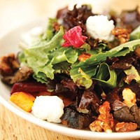 Garden harvest salad with roasted vegetables, goat cheese and spiced walnuts.