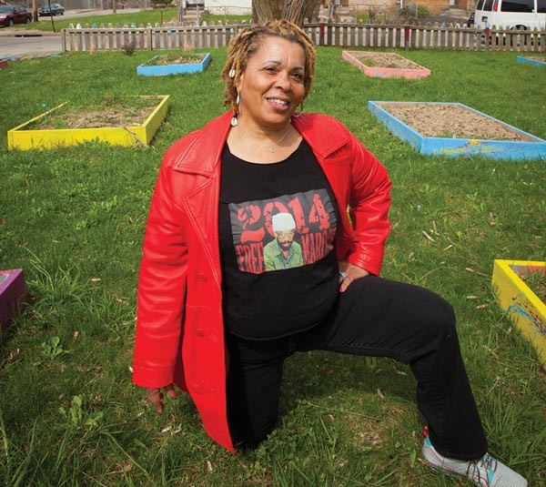 Gardener and activist Ayanna Rauf poses at The Murtland Avenue Garden near Westinghouse High School, in Homewood.