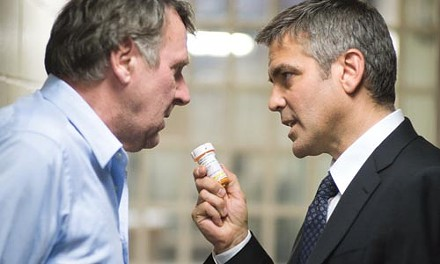 George Clooney (right) doctors his off-the-rails colleague (Tom Wilkinson).