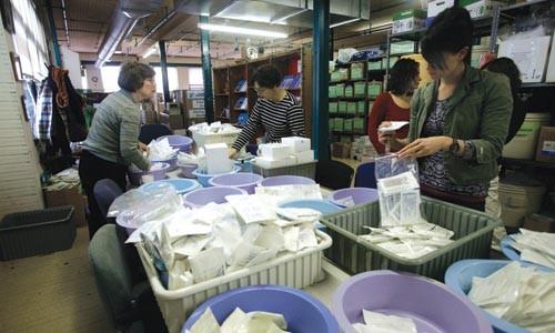 Global Links volunteers process medical surplus for shipment overseas. - HEATHER MULL