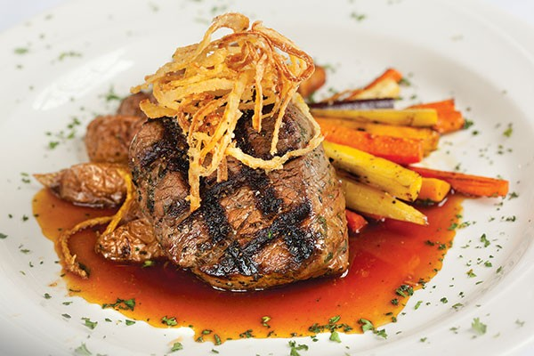 Grass-fed filet mignon with red wine demi-glaze and crispy onions, grilled rainbow carrots and roasted new potatoes