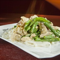 Asiatique Thai Bistro Green curry with chicken on rice noodles Photo by Heather Mull