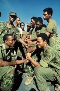Greetings: Soldiers in Vietnam do the dap. - PHOTO COURTESY OF HEINZ HISTORY CENTER.