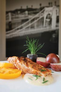 Grilled Atlantic salmon with redskin potatoes and yellow tomatoes