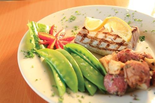 Grilled mahi mahi with lemon butter, fresh peas and roasted redskin potatoes - PHOTO BY HEATHER MULL
