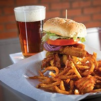 Half-pound Stack'd Burger with cheddar cheese, bacon, cheese sticks, lettuce, tomatoes, onions and curly fries