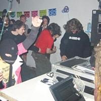 Laptop musicians battle in the Galactic AssDragon Classic