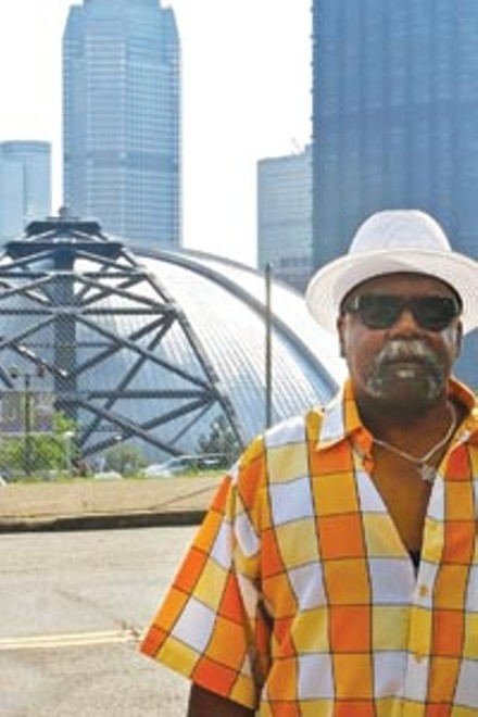 Henderson Hill says the Mellon Arena destroyed the Hill District, but is still against its demolition. - JOHN PRICE