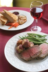 Herb-crusted beef tenderloin with rosemary redskin potatoes and garlic green beans