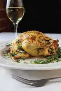 Herb-roasted free-range Cornish game hen with sweet-pea bread stuffing