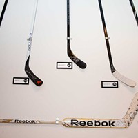 Blue Line Grille Hockey sticks Photo by Heather Mull